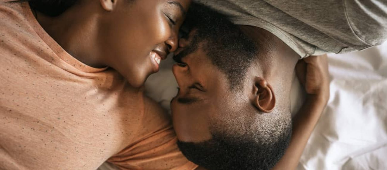 Affectionate,Young,African,American,Couple,Lovingly,Kissing,While,Lying,Face